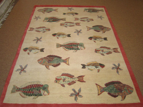 Beach house rugs something fishy is going on colony for Fish area rug