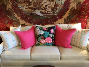 Lee Industries Sofa in Riva Bone adorned with Jacks II Pillows, Willow Basket in Dark Pink Pillows & Chiang Mai Pillow in Ebony.